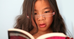 child reading glasses